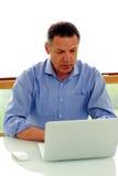 Caucasian man looking at his laptop computer Stock Photos
