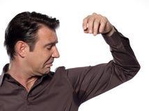 Caucasian man looking at sweat stain perspiring Stock Photo