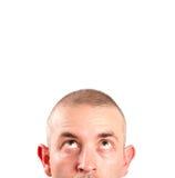 Caucasian man looking up Stock Photo