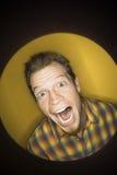 Caucasian man making funny face. stock photo