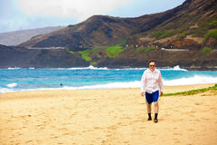 Caucasian man in mid forties on Hawaiian beach Stock Photo