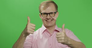 Caucasian man in pink shirt show thumbs up. Chroma key royalty free stock image