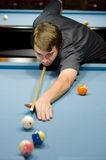 Caucasian man playing pool Royalty Free Stock Photos