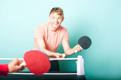 Caucasian man playing table tennis with friend Stock Image