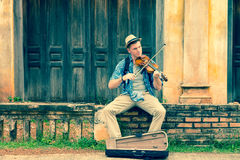 Caucasian man playing violin Royalty Free Stock Image