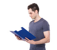 Caucasian man read on document work Stock Images
