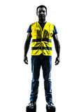 Caucasian man safety vest standing silhouette. One man standing in yellow safety vest silhouette isolated in white background Stock Photos