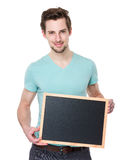 Caucasian man show with chalkboard Royalty Free Stock Photo