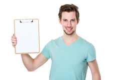 Caucasian man show with clipboard. Isolated on white background Royalty Free Stock Images