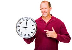 Caucasian man showing clock Stock Images