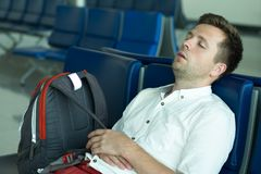 Caucasian man is sleeping in lounge area at the airport. stock photos
