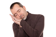 Caucasian man is sleeping standing up Stock Photo
