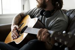 Caucasian man in a songwriting process Royalty Free Stock Photography