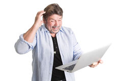 Caucasian man standing with computer. Royalty Free Stock Images