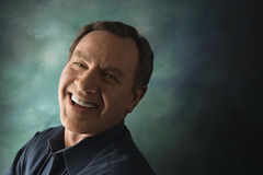 Caucasian man on studio background. Laughing middle-aged Caucasian man on studio background Stock Image
