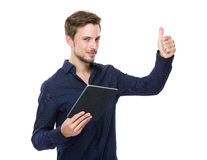 Caucasian man with tablet and thumb up Royalty Free Stock Images
