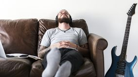 Caucasian man taking a break from work by listening to music stress relief concept Stock Image