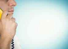 Caucasian man talking on a landline phone. Royalty Free Stock Photography