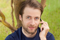 Caucasian man talking on a mobile phone outdoor Stock Image
