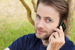 Caucasian man talking on a mobile phone outdoor Stock Images