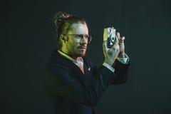 Caucasian man in tuxedo taking photo on point-and-shoot camera Royalty Free Stock Photo