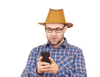 Caucasian man typing a message on mobile phone. Stock Image