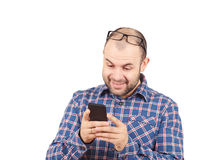 Caucasian man typing a message on mobile phone. Royalty Free Stock Images