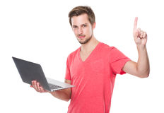 Caucasian Man use of laptop and finger up Royalty Free Stock Image