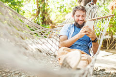 Caucasian man using an app on his mobile phone Royalty Free Stock Photo