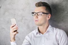 Caucasian man using cell phone Royalty Free Stock Photo