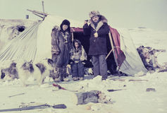 Caucasian man visiting remote station of the indigenous people Chukchi Stock Images