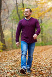 Caucasian man walking in the forest Stock Photos