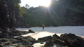 Caucasian Man Walking by Lonely Tropical Paradise Beach. 4k UHD stock video