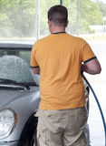 Caucasian Man Washes Car Royalty Free Stock Photos