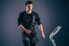 Man training on stepper with electric muscle stimulation. Caucasian man wearing biometric fitness vest training on stepper with electric muscle stimulation Royalty Free Stock Photo