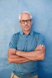 Caucasian man wearing glasses staring at camera Royalty Free Stock Photography