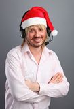Caucasian man wearing headset with christmas hat Royalty Free Stock Images