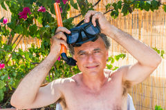 Caucasian man wearing mask and snorkel Royalty Free Stock Image