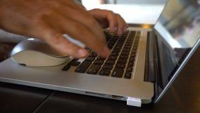 Caucasian man working on laptop at Asian restaurant