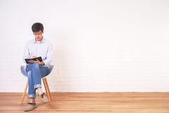 Caucasian man writing notepad interior Stock Image