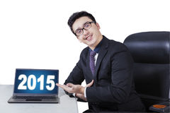 Caucasian manager presenting number 2015 Royalty Free Stock Images