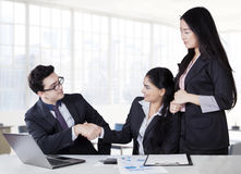 Caucasian manager shaking hands with partner Royalty Free Stock Photos
