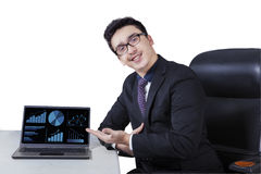 Caucasian manager showing financial chart Royalty Free Stock Photo