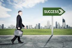Caucasian manager walking toward success way stock images