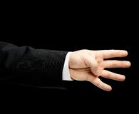 Caucasian manlig hand i en isolerad affärsdräkt Royaltyfri Foto