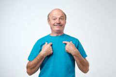 Caucasian mature man pointing to himself with question if he did something wrong. You talking to me. Caucasian mature man pointing to himself with question if royalty free stock photos
