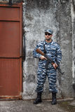 Caucasian military man with rifle in urban warfare Stock Photography