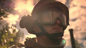 Caucasian ,military officer in helmet is looking straight while sunlights are reflected on him, hopeful illustration. Calm defender standing stock video footage