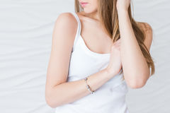 Caucasian model with brown hair in white singlet. Sexy closeup portrait noface only lips Stock Photography