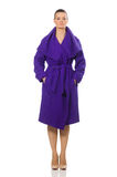 The caucasian model in purple coat isolated on white Stock Image